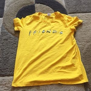 a yellow friends tee